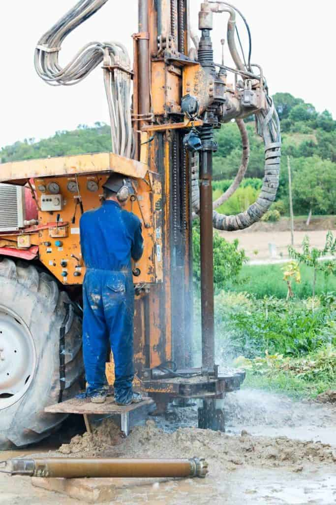 An engineer is operating a well drilling rig.